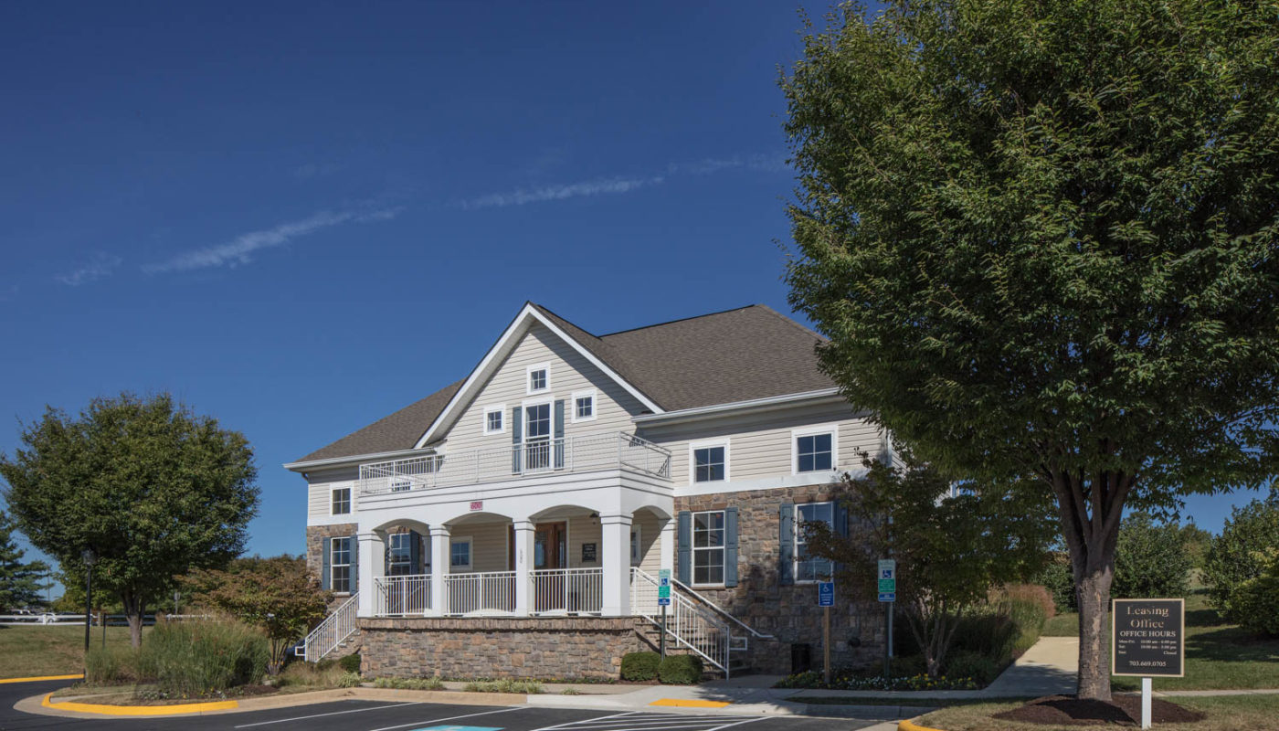 somerset park leasing office and resident lounge with trees, green landscaping and blue sky - jefferson apartment group