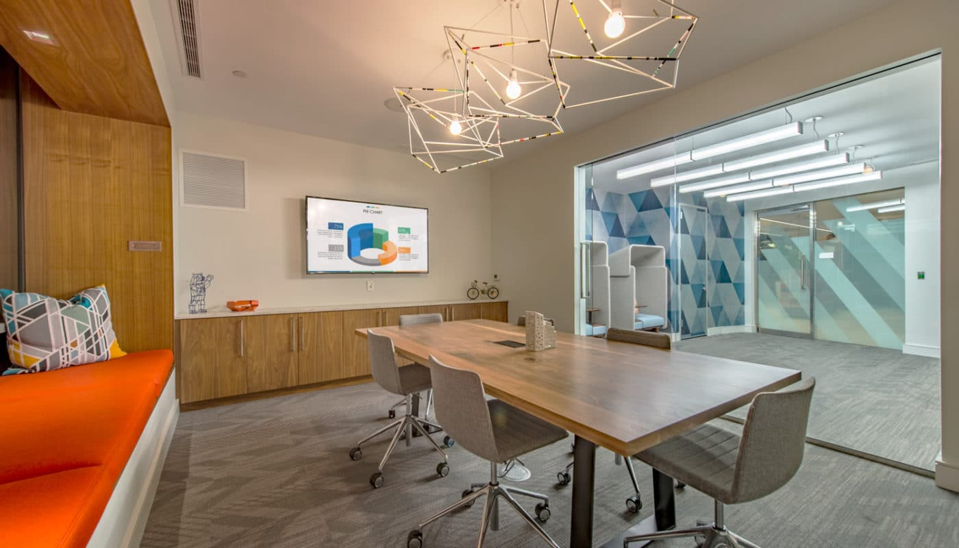 j malden center resident conference room with table, chairs, bench seating, storage cabinet and modern lighting - jefferson apartment group