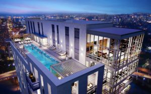 j sol aerial view of rooftop pool, outdoor living space, and resident club room - jefferson apartment group