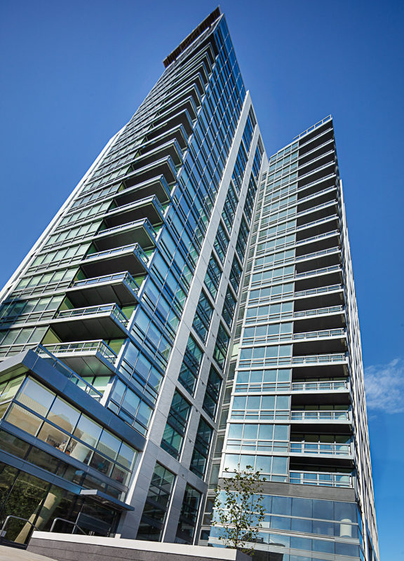 exterior of j sol luxury high rise apartments in arlington apartments