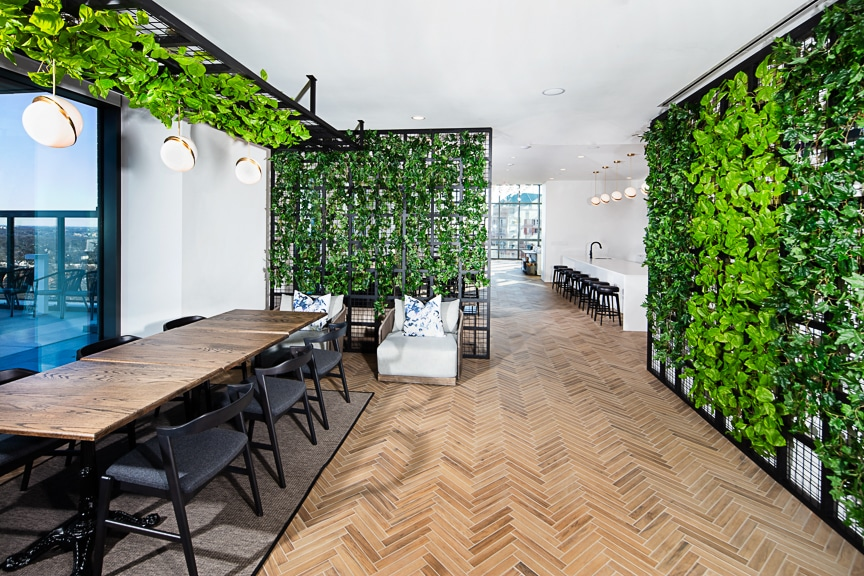 communal dining area with hanging garden at j sol arlington luxury apartments