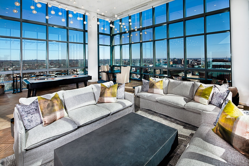 resident sky lounge with social seating, billiards and a view of washington dc at j sol luxury apts