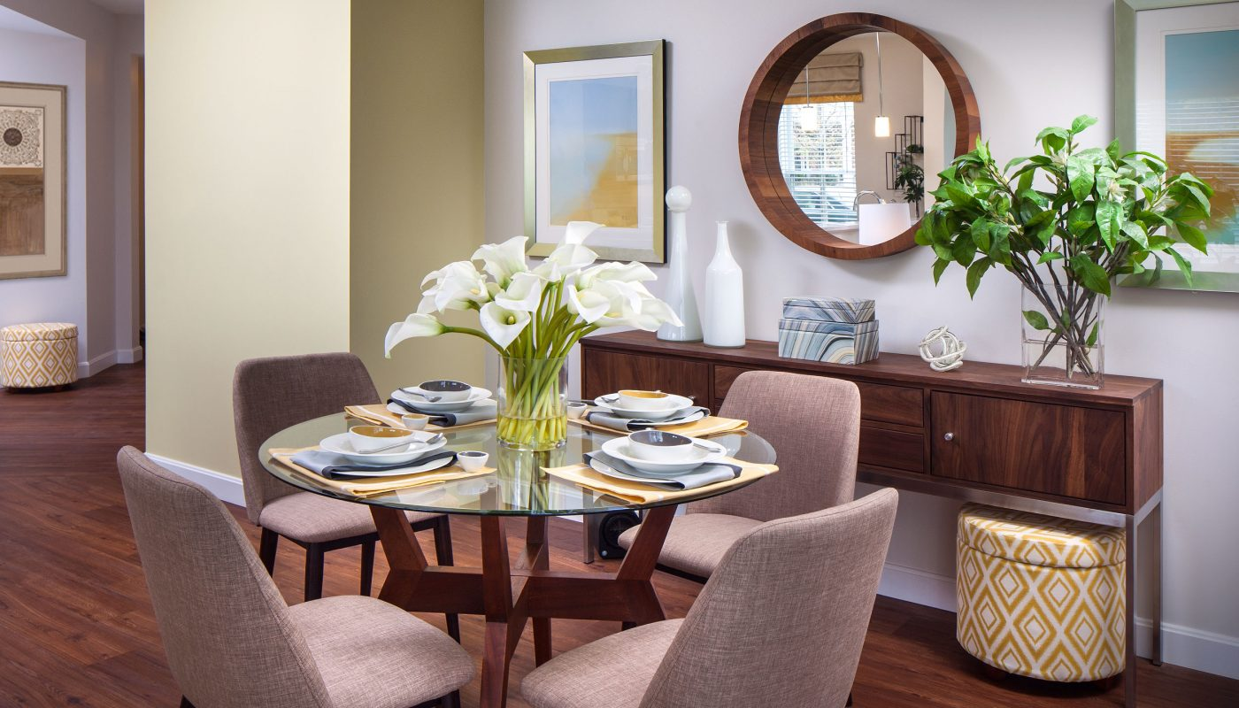 one upland dining area with table, four chairs, place settings, credenza, mirror and view of foyer - jefferson apartment group