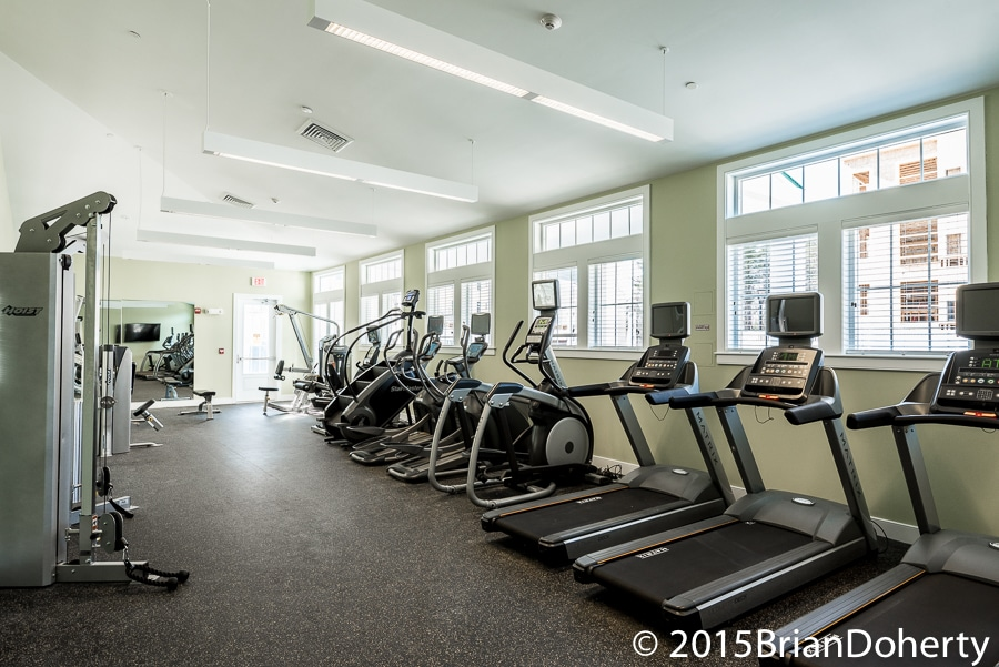 one upland fitness center with cardio machines, strength training equipment, large windows and flat screen tv - jefferson apartment group
