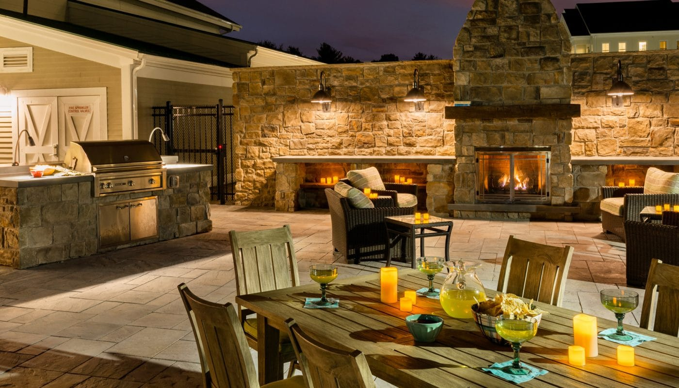 one upland outdoor living area with grilling stations, fireplace, dining tables, and social seating - jefferson apartment group