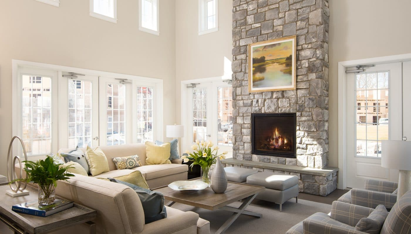 one upland resident lounge with couches, chairs, coffee table, fireplace and french doors - jefferson apartment group