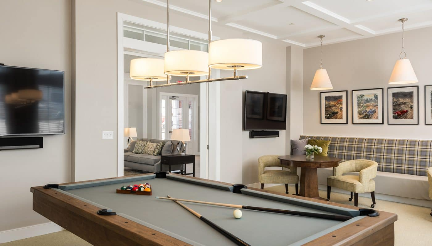 one upland game room with billiards table, social seating, cocktail tables, and flat screen tv - jefferson apartment group