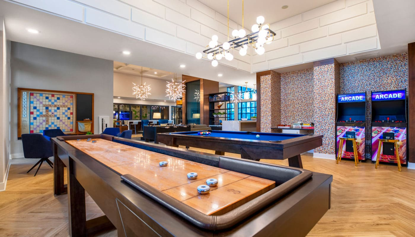 jefferson mount laurel large game room with shuffleboard, pool table, scrabble and arcade games - jefferson apartment group