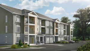 rendering of jefferson mount laurel apartment exterior showing three story building with balconies, private garages, and stone accents - jefferson apartment group