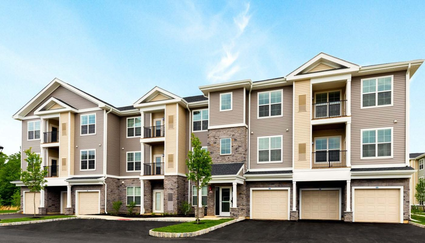 jefferson mount laurel exterior showing a three story apartment building with balconies, private garages and large driveway - jefferson apartment group