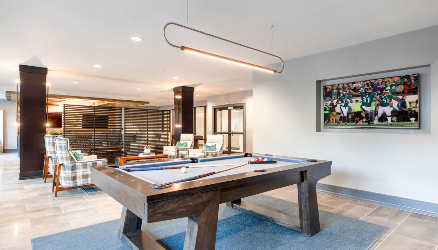 j creekside clubroom with billiards, flat screen tv, social seating and modern lighting - jefferson apartment group