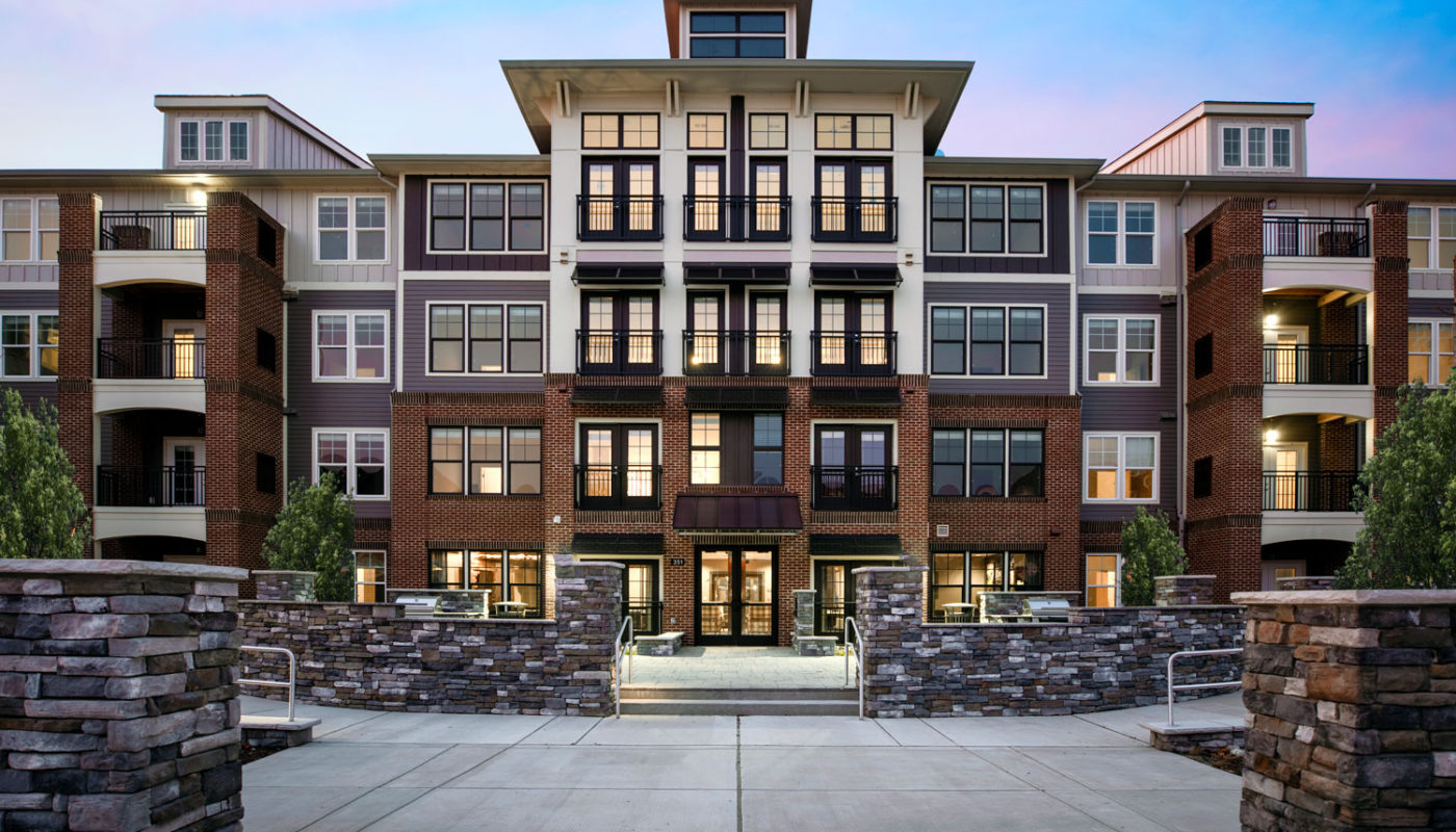 j creekside exterior with balconies and stone accents - jefferson apartment group