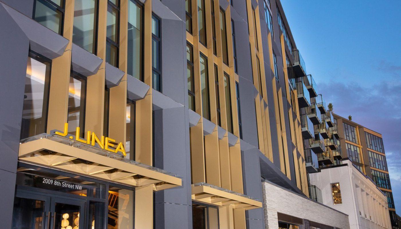 exterior signage of J linea, a high rise apartment building