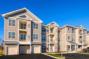 jefferson mount laurel exterior showing three story building with balconies and private garages - jefferson apartment group