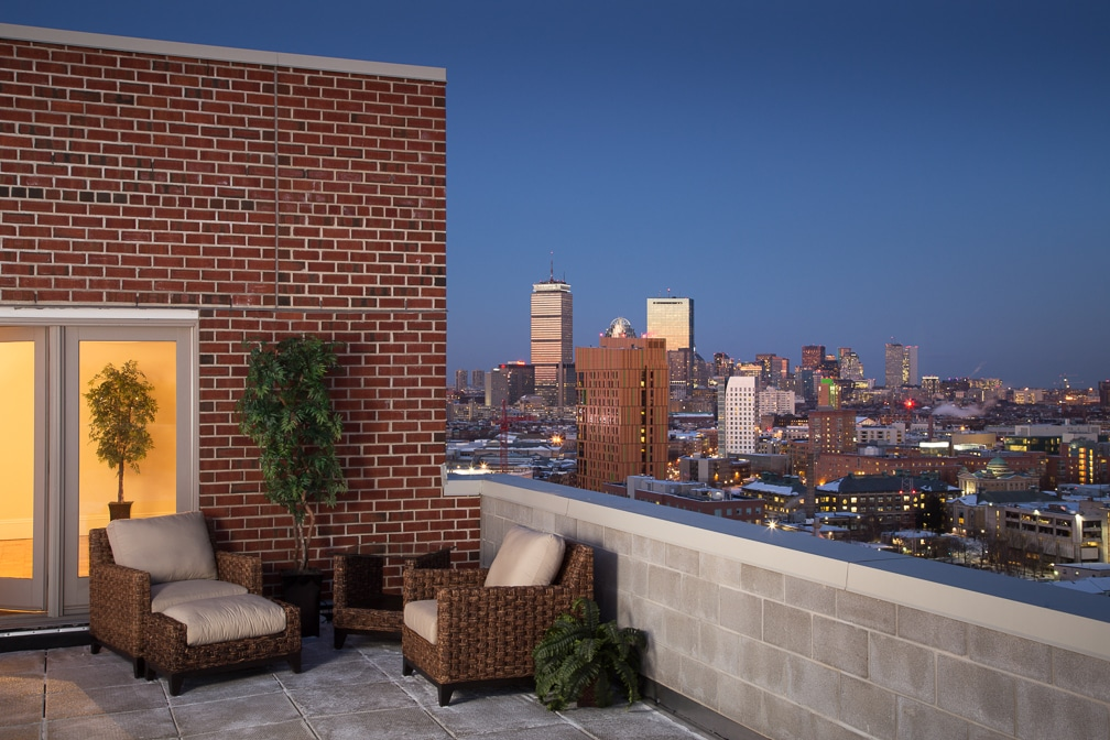 cityview at longwood Roofdeck with dusk view of Boston skyline - jefferson apartment group