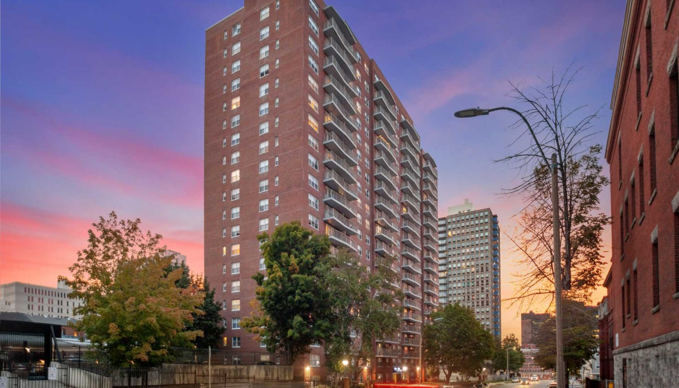 cityview at longwood High-rise building exterior at sunset - jefferson apartment group