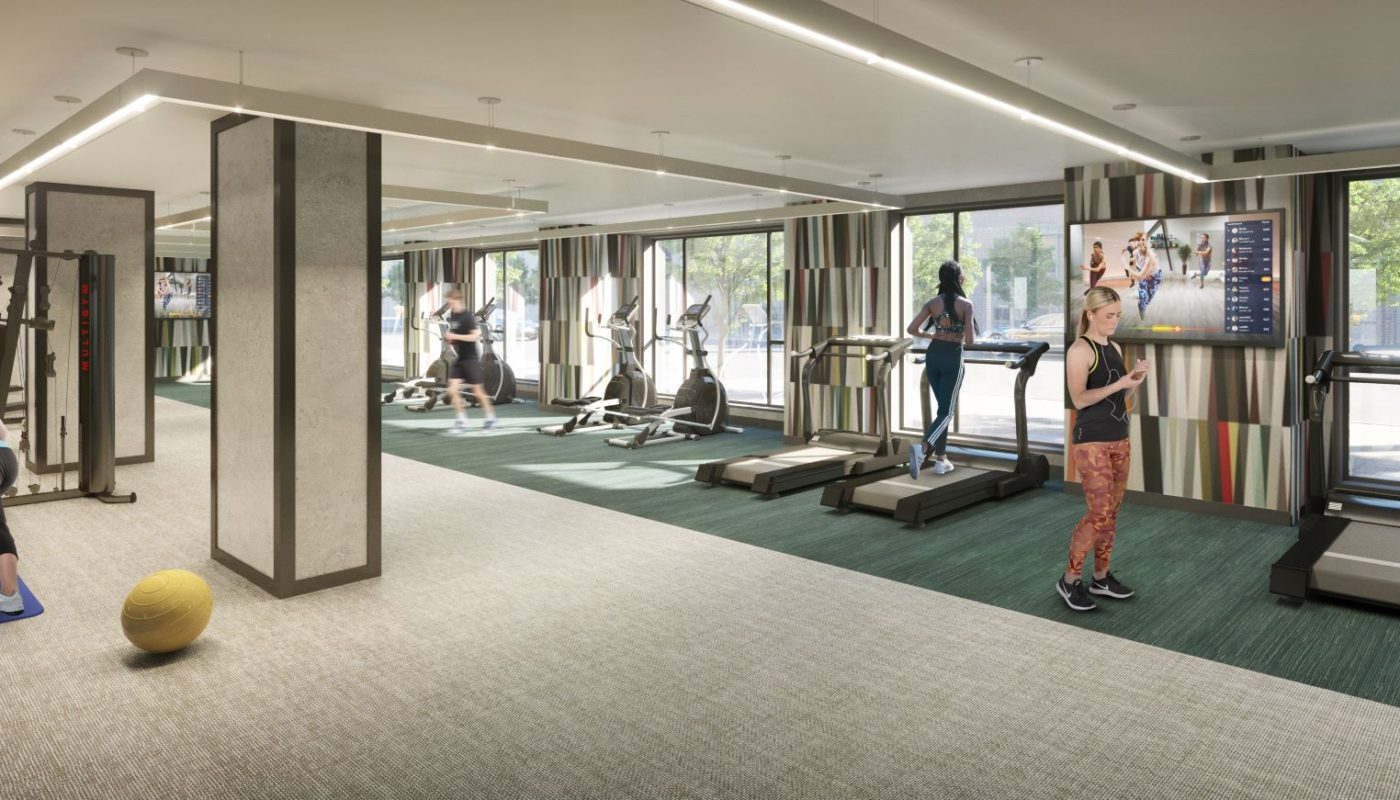 people working out at the j vue fitness center and yoga studio at j vue apartments in boston ma