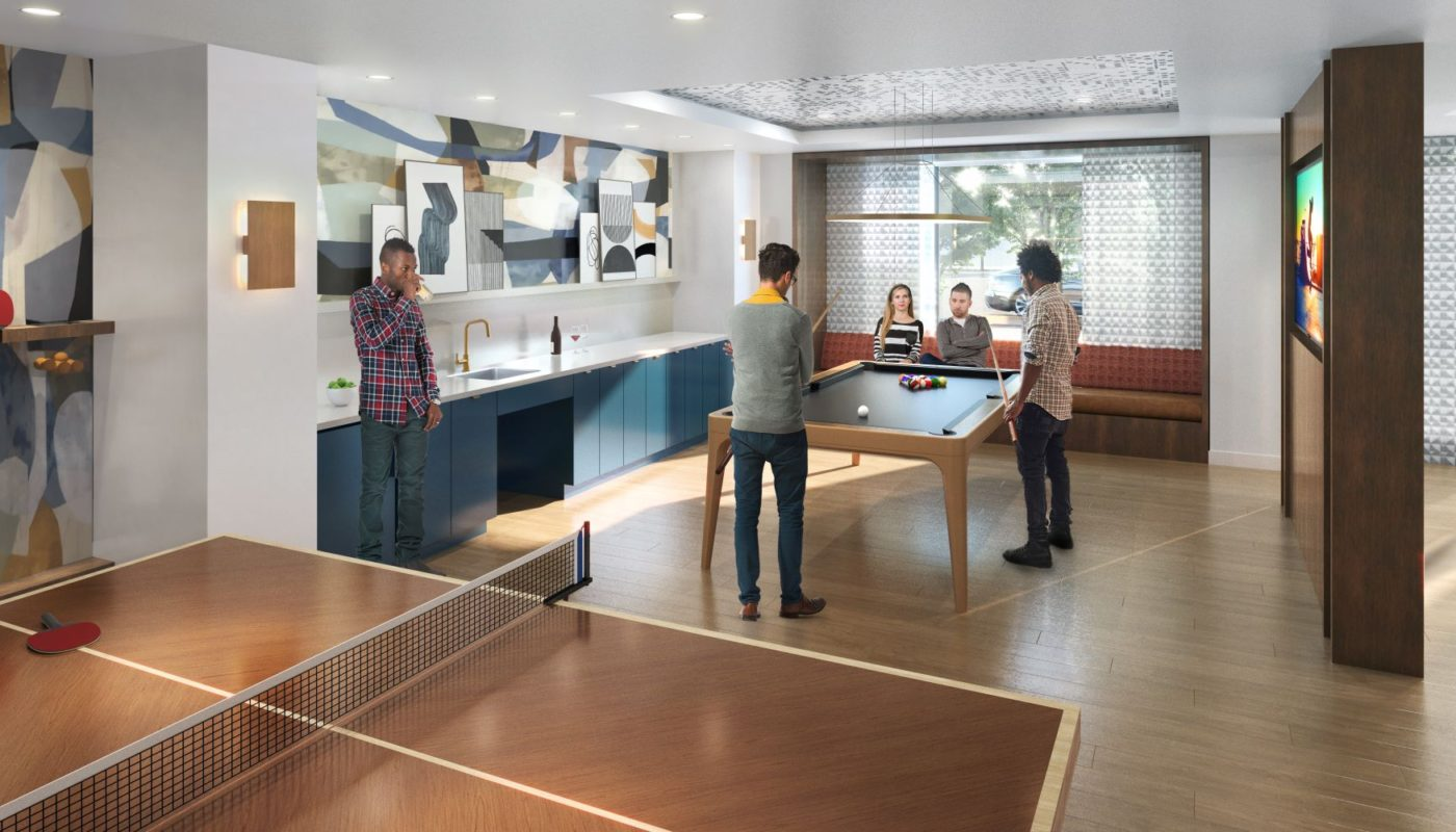friends shooting pool in game lounge with ping pong table, kitchen, flat screen tv, billiards table and social seating