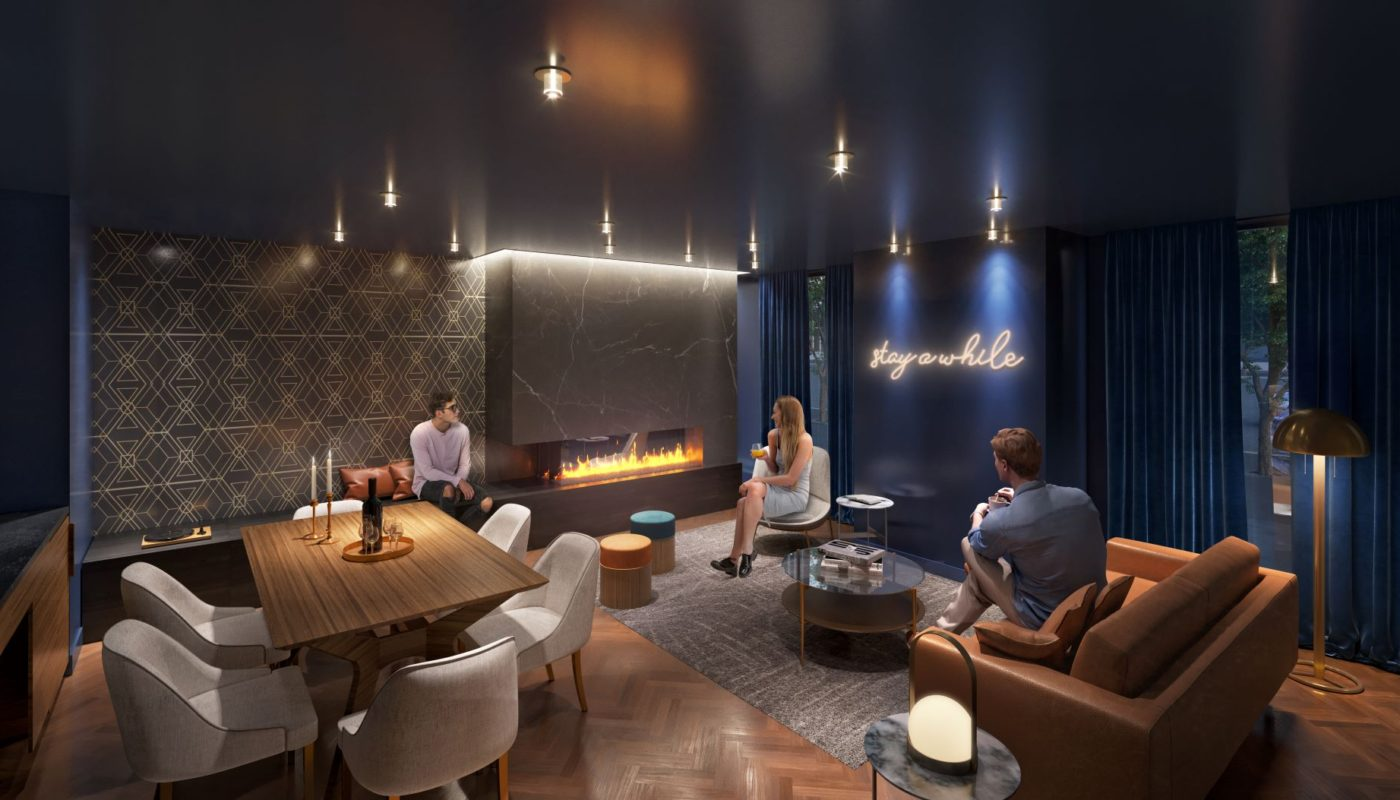 people socializing in the social lounge with social seating, dining table and fireplace