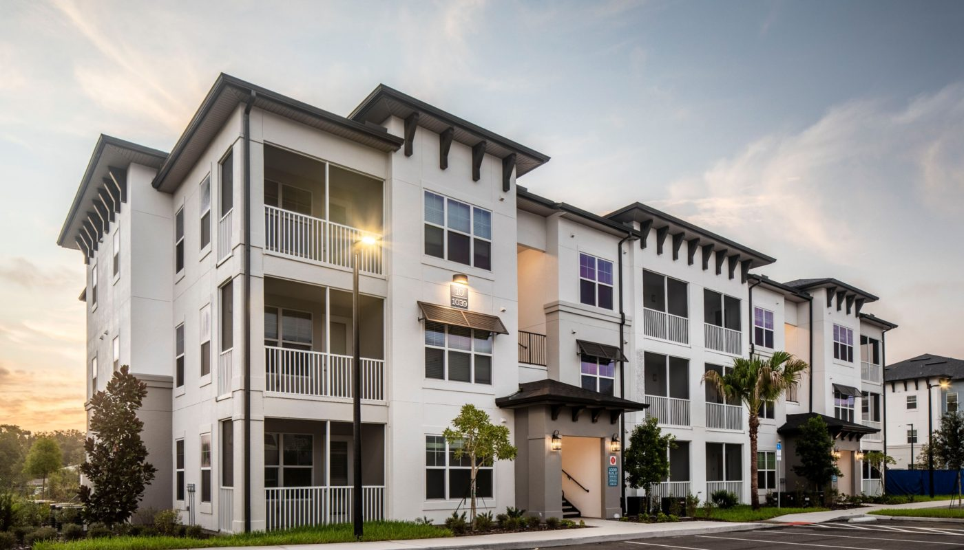 exterior of 3 story apartment building with screened in balconies at jefferson lake howell luxury apartments in Casselberry