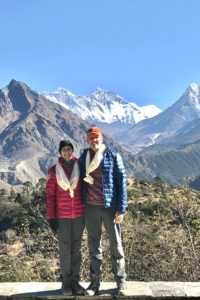 jim and cynthia butz in front of mount everest - jefferson apartment group