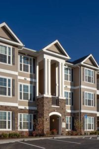 exterior of 3 story apartment building with stone accents at jefferson somerset park apartments in mount laurel NJ