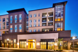 exterior of scout on the circle, a 4 story mutlituse building with 3 stories of apartments and 1 story of retail in fairfax va