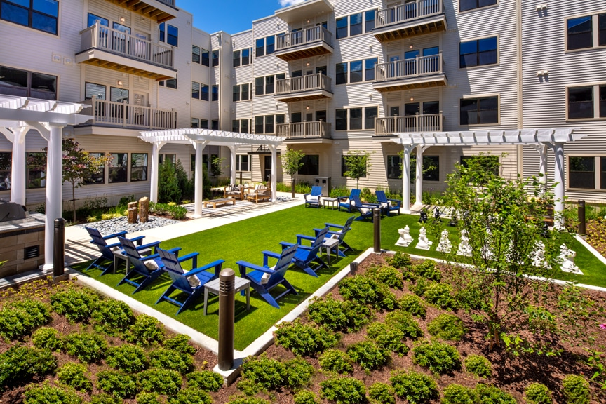 Courtyard with social seating and large chess board at atelier luxury silver spring apartments