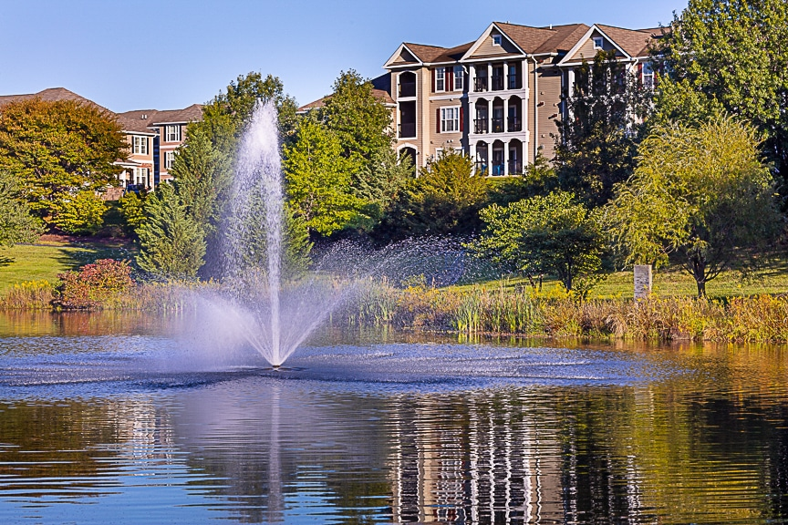 water feature, trees and building exterior - jefferson somerset park apartments