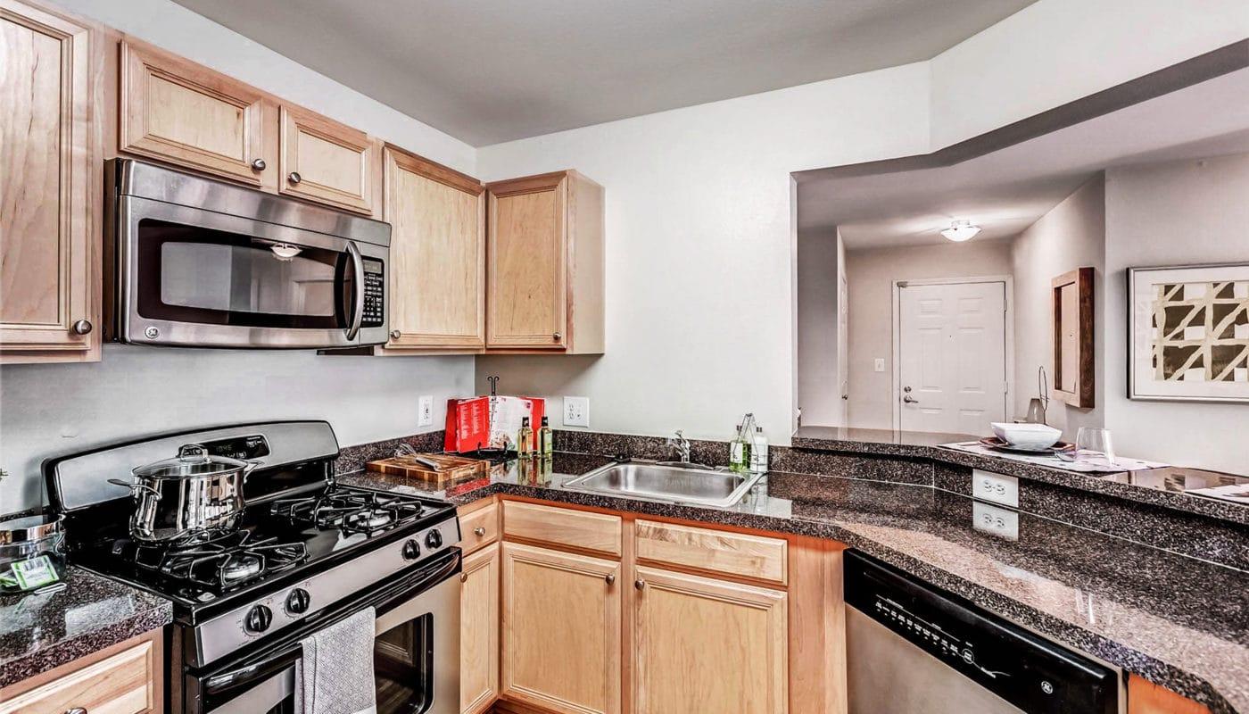 kitchen with stainless steel appliances - J Harbor Park reston va apartments